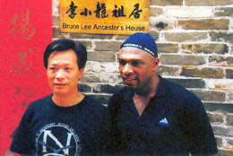 Garry with Sifu Ha Ji Sing outide Bruce Lee's ancestors house in Seun Dak, Southern China.